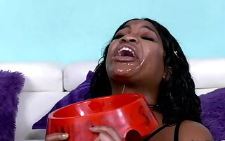 The guys degrade black whore while she is restrained by fucking her throat hard