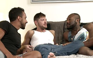 White gay dude strokes his cock while getting fucked by two black guys