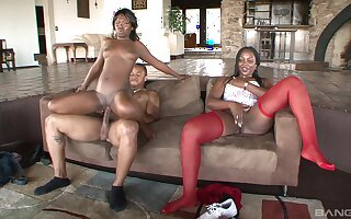 Ebony babes Coco Ray and Ms Townsend share one very big dick