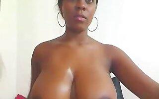 Dark-skinned busty gal toying snatch
