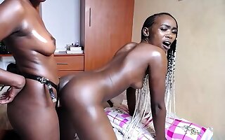 Three hot African girls lose one's heart to each outer regarding strapon live at